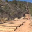 Womwalking down Manitou Incline — Stock Video #21165009