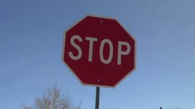 Stop sign with right to left trucking — Stock Video