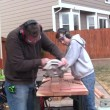 Man and boy sawing — Stock Video