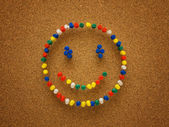Thumbtack smiley face — Stock Photo