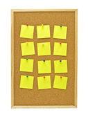 Office cork board with yellow post it notes — Stock Photo