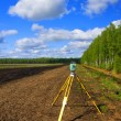 A total station on a tripod — Stock Photo