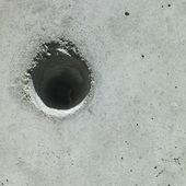 Hole in concrete — Stock Photo