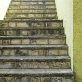 Stone stairs and yellow wall — Stock Photo