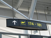 Gate signs at airport — Stock Photo