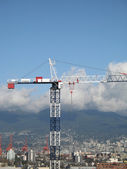 Construction crane and cityscape — 图库照片