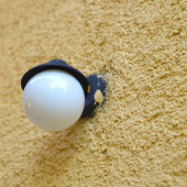 Light on a stucco wall — Stock Photo