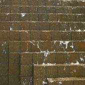 Water cascading down on bricks — Stock Photo