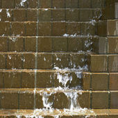 Water cascading down on bricks — Stock Photo