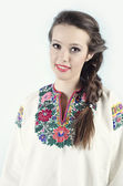 Girl in ukrainian cloth on white background — Stock Photo