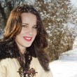 Smiling woman with snow on her hair — Stock Photo