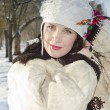 Woman in tradition cloth in winter — Stock Photo