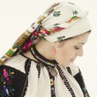 Woman in traditional ukrainian cloth on snow — Stock Photo