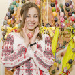 Nice smiling girl with Easter Egg are standing on backgroung of — Stockfoto