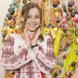 Nice smiling girl with Easter Egg are standing on backgroung of — 图库照片