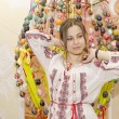 Nice girl are standing on backgroung of Easter Eggs  — Stok fotoğraf