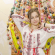 Nice girl are standing on backgroung of Easter Eggs — Stockfoto #24081167