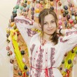 Nice girl are standing on backgroung of Easter Eggs — ストック写真
