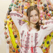 Stockfoto: Nice girl are standing on backgroung of Easter Eggs