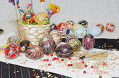Easter eggs on white and black weaving background — Stock Photo