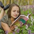 Stock Photo: Portrait of beautiful girl with book in corydalis