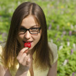 Stock Photo: Portrait of beautiful girl with strawberry in spring forest
