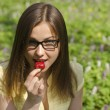 Portrait of beautiful girl with strawberry in spring forest — Stock Photo