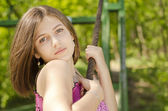 Portrait of beautiful smiling girl in park — Stok fotoğraf