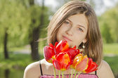 Portrait of beautiful girl with tulips — Stock Photo