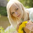Portrait of beautiful blonde girl with wreath of dandelion — Stock Photo #26049061