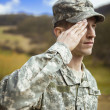 Saluting male army soldier — Foto de stock #23574243