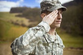 Saluting male army soldier — Photo