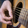 Guitarist is playing acoustic guitar — Stock Photo