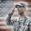 Soldier saluting on the flag background — Stock Photo