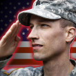 Soldier saluting on the flag background - Stock Photo