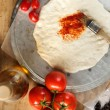 Pizza dough and tomato paste — Stock Photo