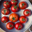 Stock Photo: Rustic tomatoes. Top view. Vintage purple toning