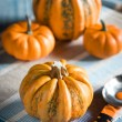 Four pumpkins and a scoop — Stock Photo #31998201