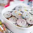 Bowl of sprinkled holiday cookies — Stock Photo