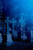 Old misty graveyard at night — Stock Photo