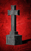 Cross tombstone on bright red grunge background — Stock Photo