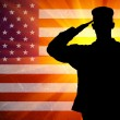 Proud saluting male army soldier on american flag background — Stock Photo