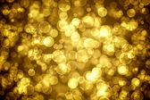 Golden glowing bokeh holiday background — Stock Photo