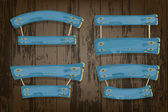Blue wooden vector banners and ribbons hanging on ropes — Stockvektor