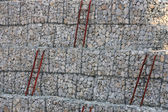 Stones in the wire or rock background — Stock Photo