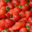 Strawberry fresh natural juicy strawberries to background on the street market — Stock Photo