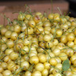 Fresh white cherries natura whitel cherry to background on the street market — Stock Photo