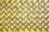 Seznam plastové žluté desky s obrazce kosočtverec — Stock fotografie
