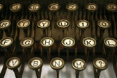 Old typing machine has and letters — Stok fotoğraf