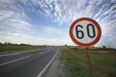 Road sing speed limit on sixty — Stock Photo